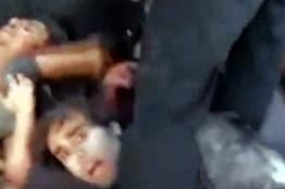 Кадр из видео, на котором изображена расправа над сирийскими военными