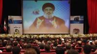 """9 мая 2013 года: лидер """"Хезболлы"""" Шейх Хасан Насралла говорит через видео во время конференции, состоявшейся в южном пригороде Бейрута, в Ливане. (AP)"""