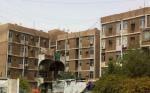 Фотография сделанная с мобильного телефона, показывает многоквартирный дом в багдадском районе Zayouna, где боевики убили 29 предполагаемых проституток Фото:. AFP / Getty