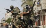 Палестинские боевики из бригад Эззедин аль-Кассам, вооруженного крыла ХАМАС, на параде в Рафах, на юге сектора Газа. Фото: AFP / Getty