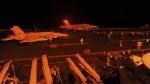 Американские F/A-18 Super Hornet готовятся к взлёту палубы авианосца USS George H.W. Bush для того, чтобы бомбить цели ISIL в Сирии.