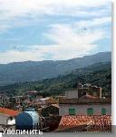 На фото НЛО слева от вертолёта гражданской обороны Италии